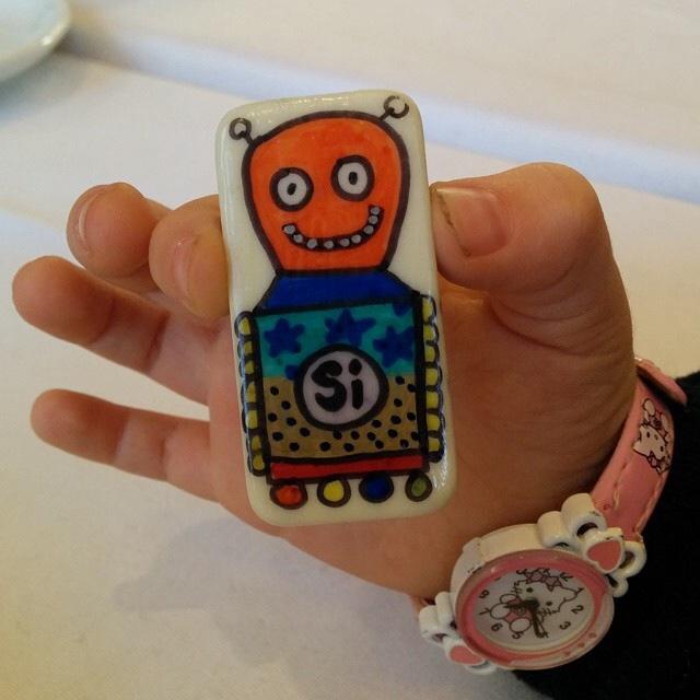 Botjoy MariaJCuesta Robot Courage Joy Hope Strength Luck activation small hand